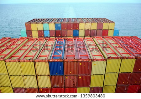 Stack of containers loaded on the big container ship.