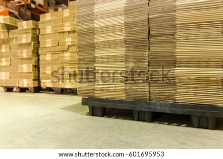 Stack of Corrugated paperboard texture in warehouse for industrial