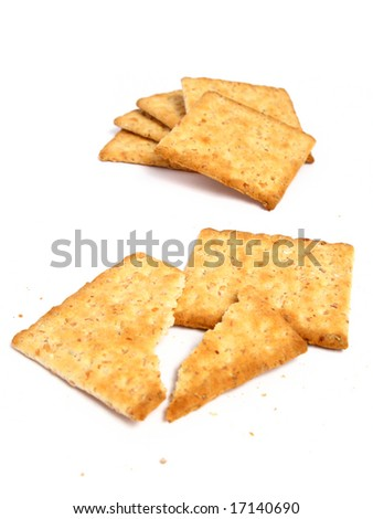 Stack of crackers on white background