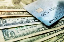 Stack of credit american dollars cash and credit card, close-up macro view.