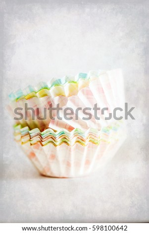 Stack of cupcake cases with texture effect. Texture background with copy space for text #598100642