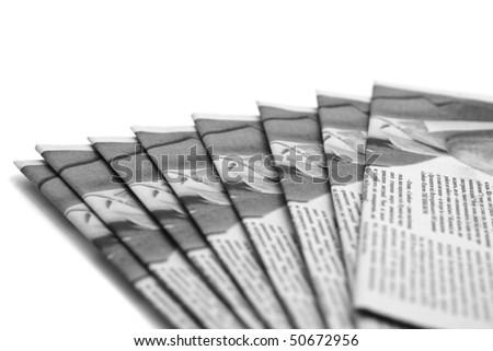 Stack of daily paper or newspapers over white (Shallow DOF)