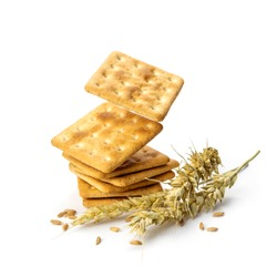 Stack of delicious bran crackers levitate on white background. Bran crackers, rye spikelets and grains isolated on white background.