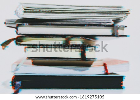 Stack of different notebooks and sketchbooks in a glitch effect