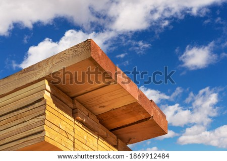 Stack of dimensional lumber for home construction with partly cloudy sky.  Photo stock ©