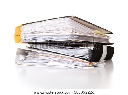 Stack of documents in binders against white background