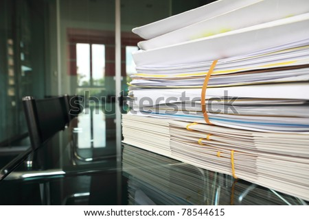 stack of documents or files in office desk