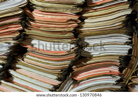 Stack of documents, papers and full binders