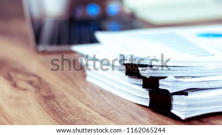 Stack of documents placed on a business desk in a business office. #1162065244