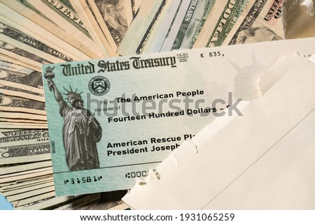 Stack of 20 dollar bills with US Treasury illustrative check to illustrate American Rescue Plan Act of 2021 payment on cash background Stock photo ©
