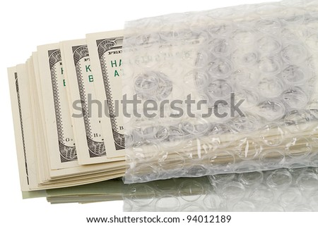 Stack of dollars in a plastic bag. Isolated on white background