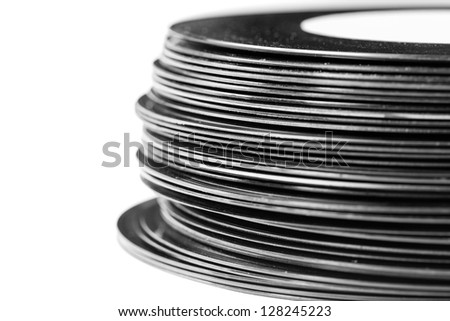 Stack of dusty vintage records isolated on a white background