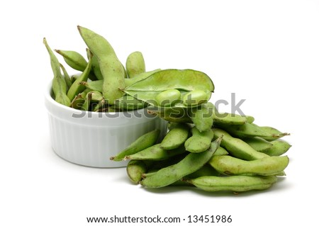Stack of edamame (green soybean) isolated on white