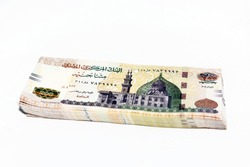 Stack of 200 Egyptian pounds banknote year 2020, obverse side has an image of Mosque of Qani-Bay Cairo, Egypt. The reverse side has an image of The Seated Scribe isolated on white background