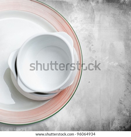 Stack of empty bowls on a plate on grunge background
