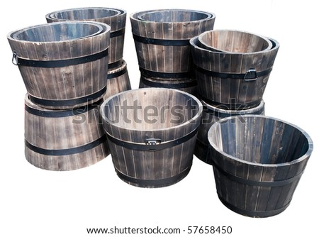 Stack of empty wooden flower pots isolated on white.