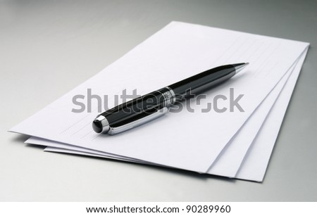 stack of envelopes on a gray table