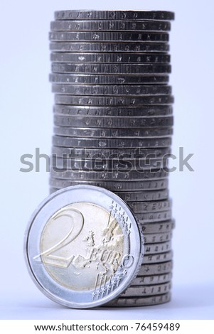 Stack of Euro coins in blue light