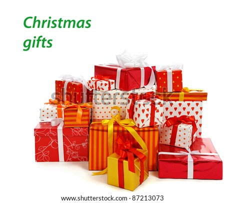 stack of festive gift boxes decorated with satin bow isolated on white background
