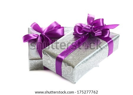 stack of festive gift boxes isolated on white background