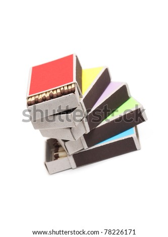 Stack of few open variegated matchboxes on white background