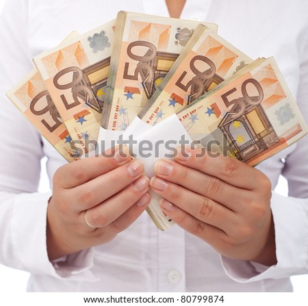 Stack of fifty euro banknotes in woman hands - closeup