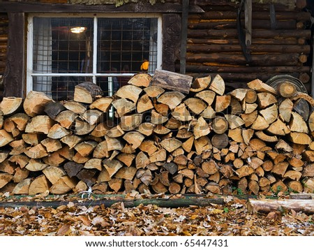 stack of firewood at loghouse
