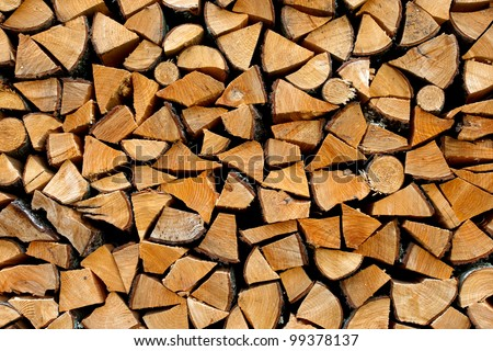 Stack of firewood - wooden abstract background