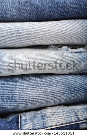 stack of folded jeans close up