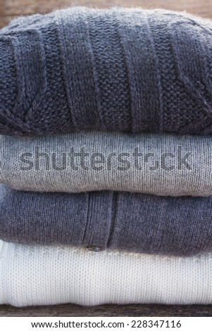 stack of folded woolen clothes close up