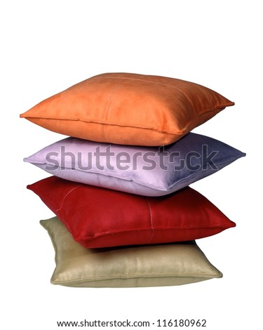 Stack of four pillows against white background