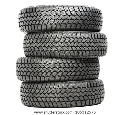 Stack of four wheel new black tyres for winter car driving isolated on white background - stock photo
