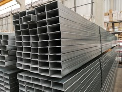 stack of galvanized rectangular steel pipes for construction supplies