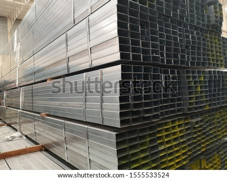 stack of galvanized rectangular steel pipes for construction supplies #1555533524