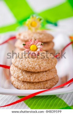 Stack of gingerbread cookies tied with red ribbon