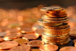 Stack of golden coin on table background and business or finance saving money