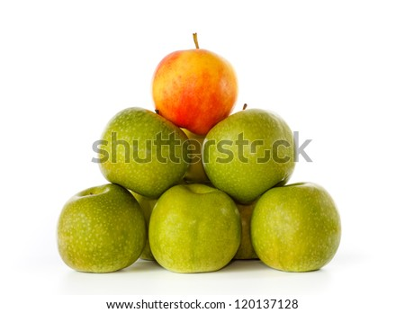 Stack of green apples and one yellow with red blush on top, against a white background