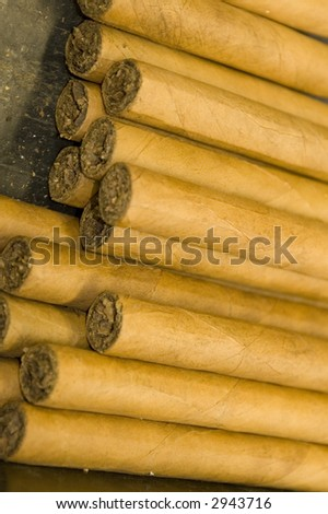 stack of hand made custom cigars luxury expensive