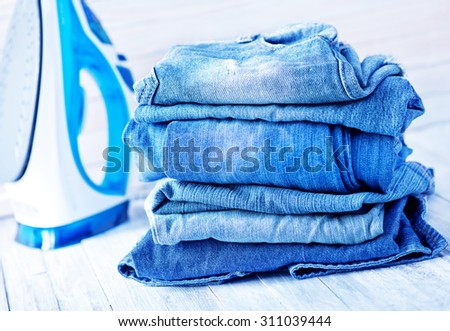 stack of jeans #311039444