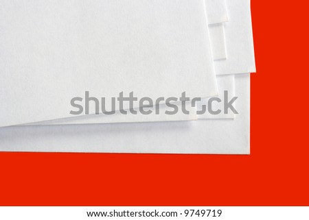 Stack of letters, isolated on red background - stock photo
