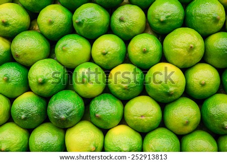 Stack of limes on display at market