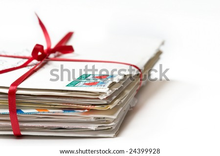 Stack of Love Letters with a Red Ribbon