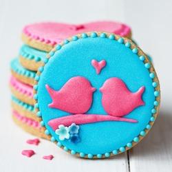 Stack of lovebird cookies