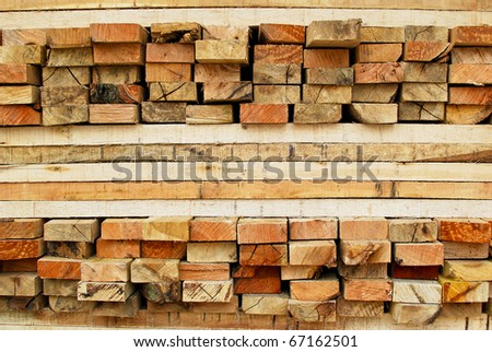 stack of lumber in timber logs storage for construction or industrial work , texture background