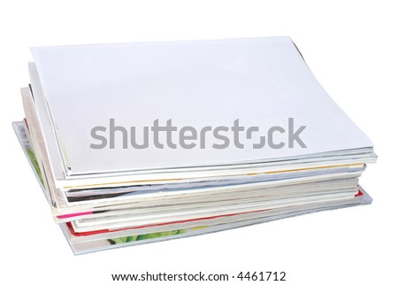 Stack of magazines. Blank white paper on the top.