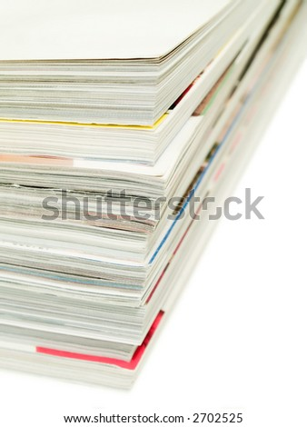 Stack of magazines isolated on a white background. Shallow DOF