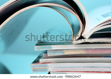 stack of magazines on blue background