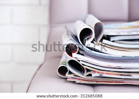 Stack of magazines on chair, close up