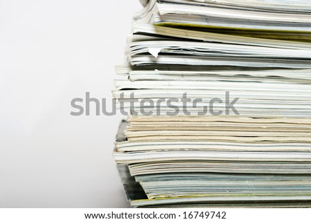 Stack of magazines on neutral background closeup - stock photo