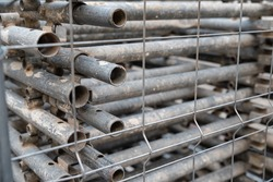 Stack of metal pipes covered with bars